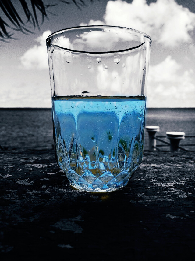 Having a glass of water.  #sea  # glass  #blue  #water