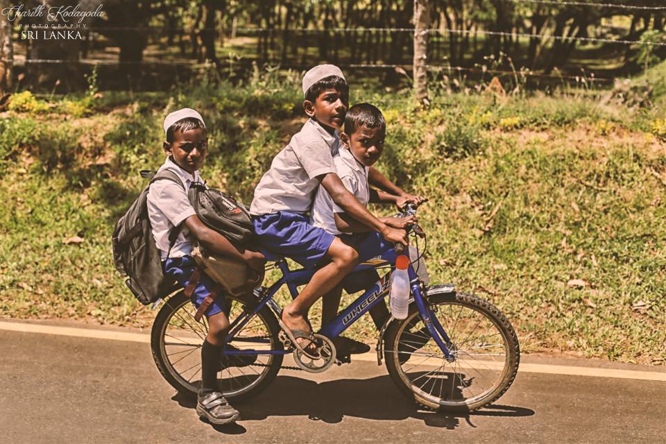 #love #photography #people  #travel #canonphotography #canon6d #srilanka #charithkodagodaphotography #children #rough #innocent #bicycle # morning  #school